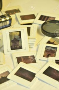 Pile of photo film slides with plastic frames of memories in vintage color style