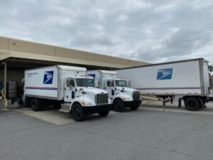 USPS Distribution Center as they transport boxes of photos to be scanned and returned